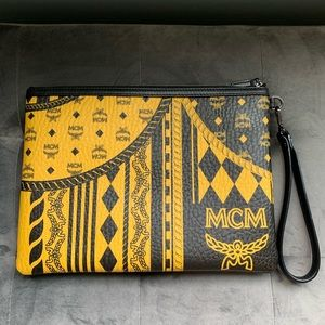 MCM large pouch wristlet in safari black/yellow